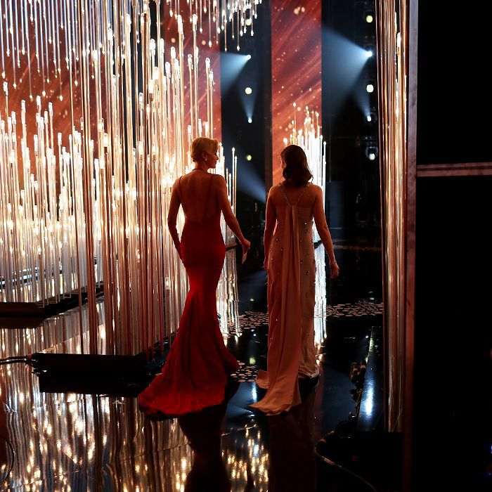 Actresses Charlize Theron and Emily Blunt walk onstage at the 88th Annual Academy Awards