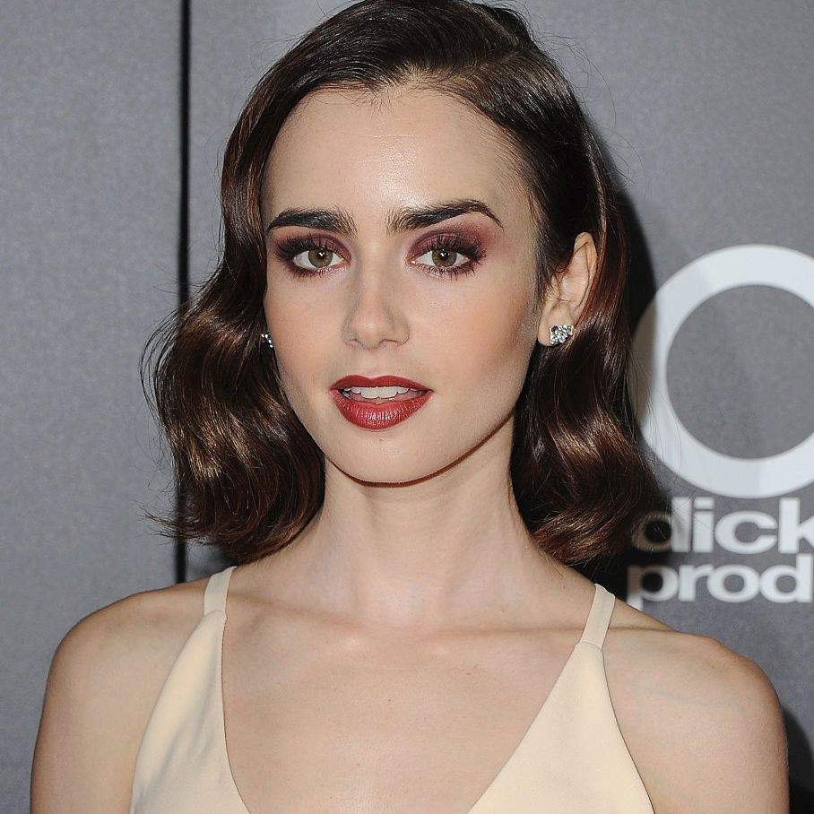 Lily Collins side-parted chic bob with retro waves