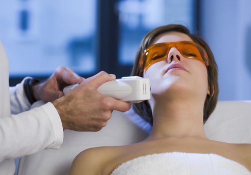 Woman getting electrolysis treatment