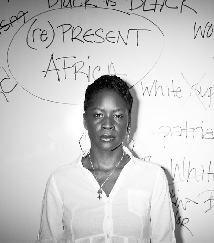 woman standing in from of a white board with words written on it