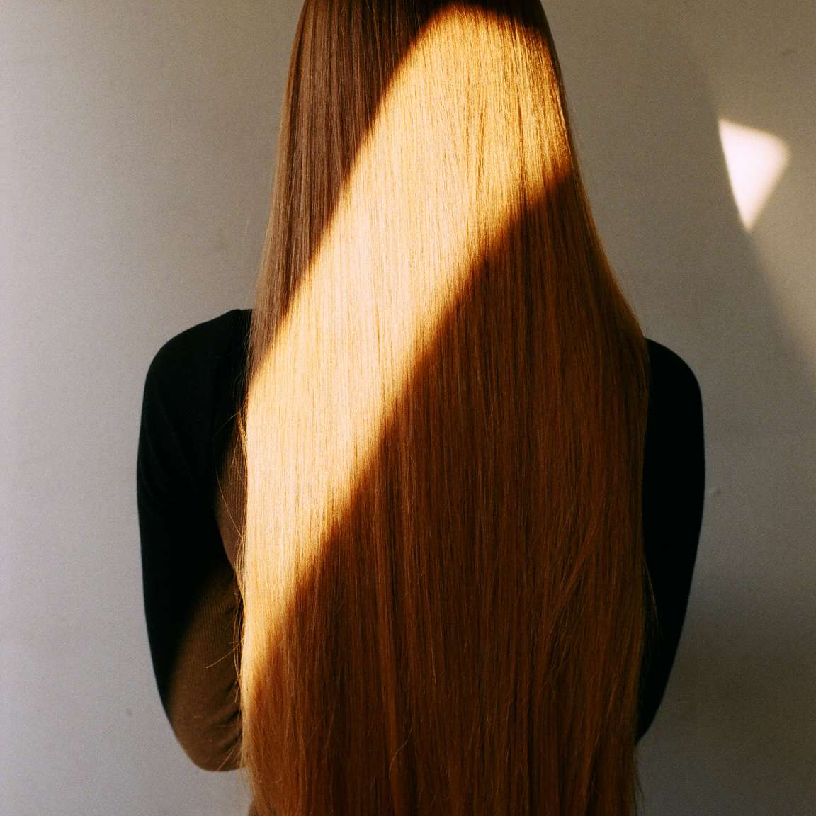woman with long red hair sunlight
