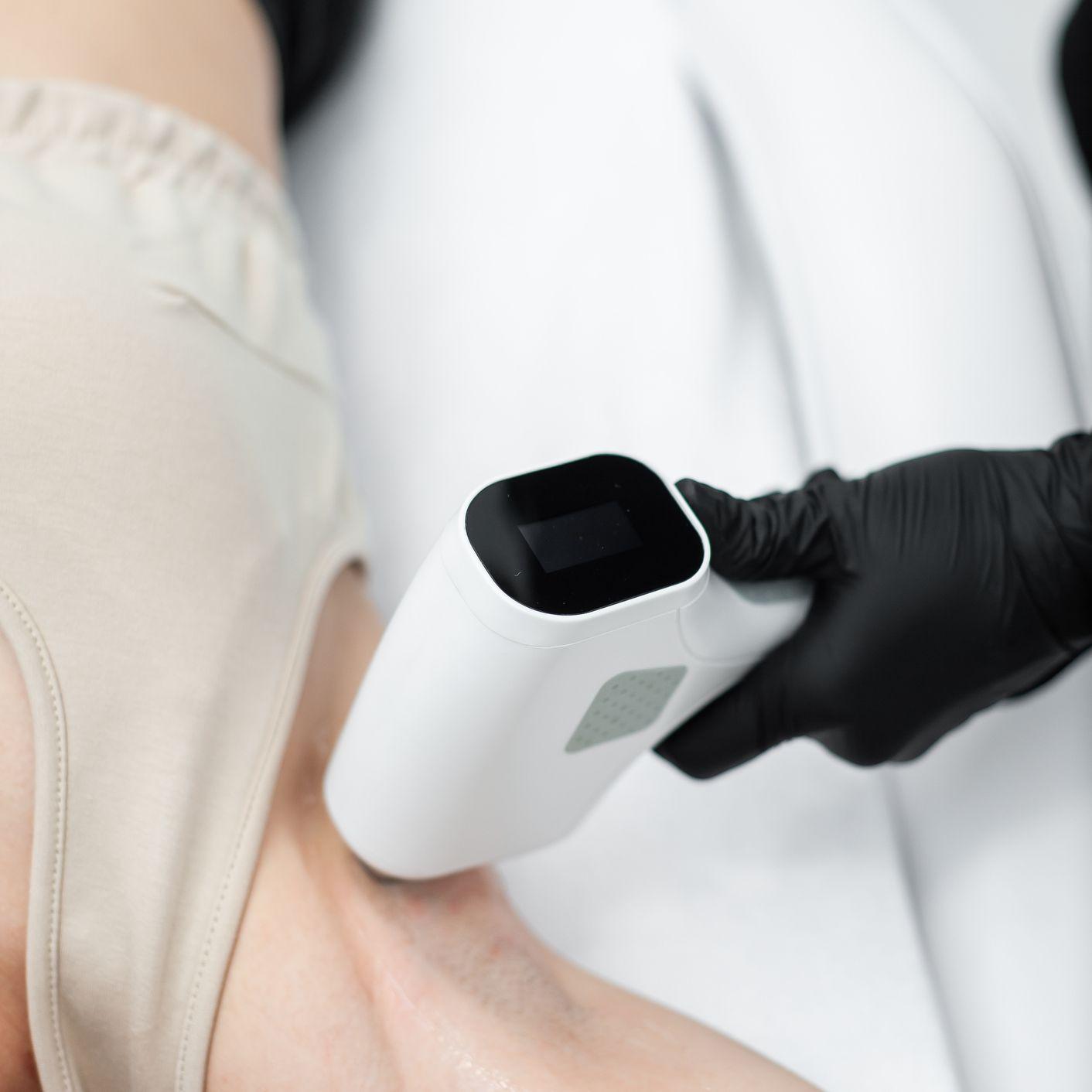 woman receiving laser removal underarm