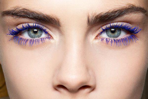 Model Cara Delevigne wearing blue mascara