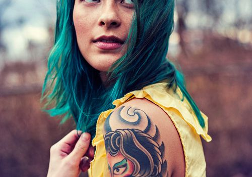 woman with tattoo sleeve and blue hair