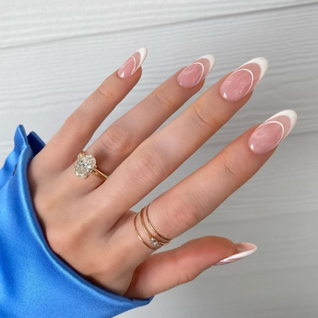 Person with accented French tips