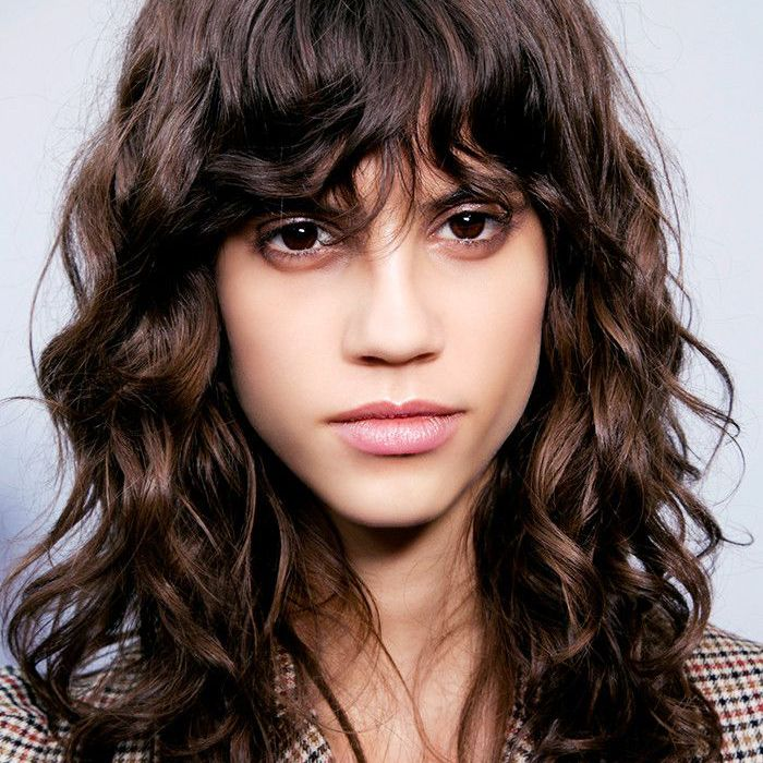 Fringes: Woman With Long Curly Hair and Fringe
