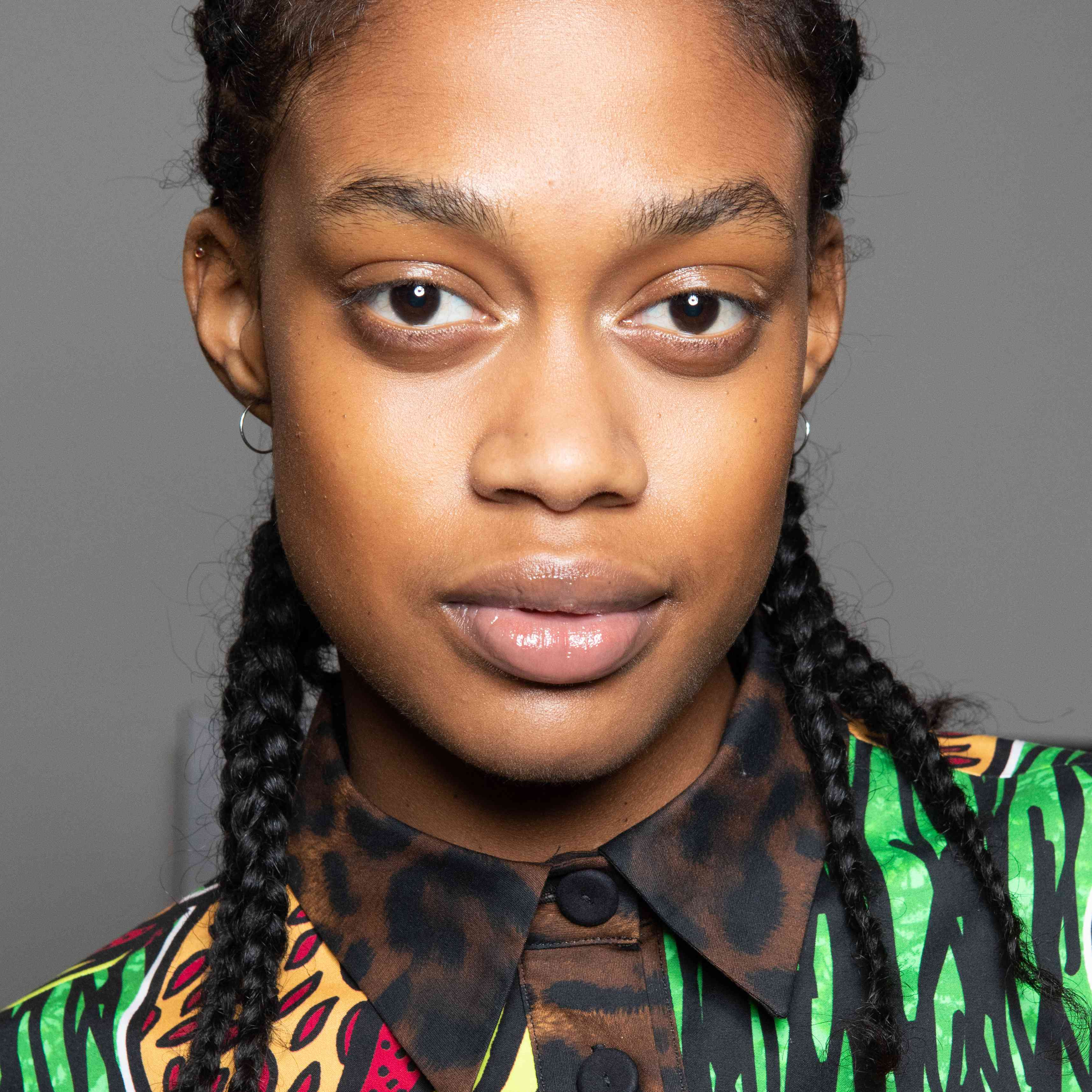 Black woman with braids and bold brows