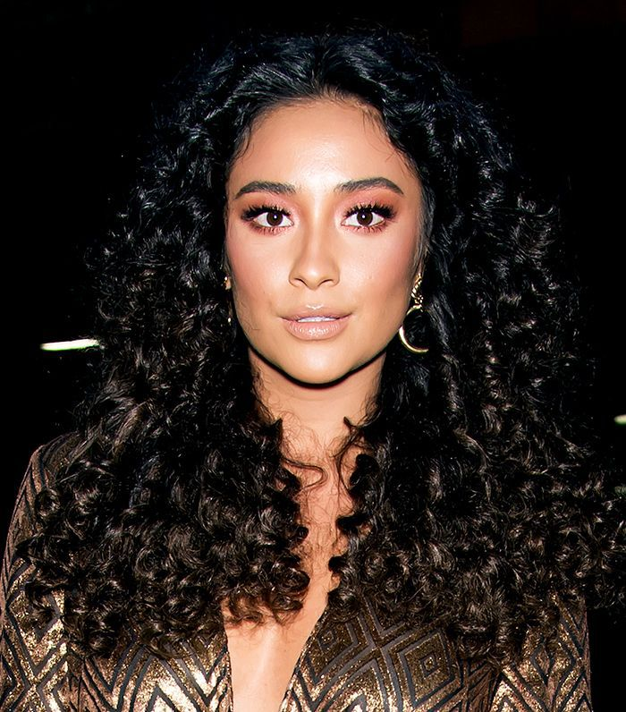 Shay Mitchell with curly hair at the Anna Sui fashion show