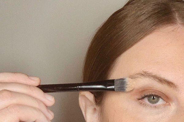makeup artist applies concealer for brows