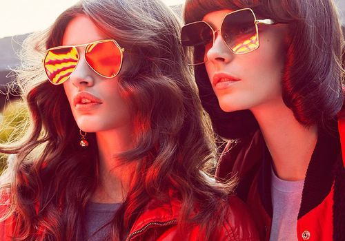 two women in red jackets with sunglasses on