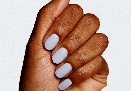closeup hand with light blue nail polish