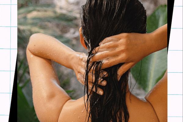 woman washing wet dark hair