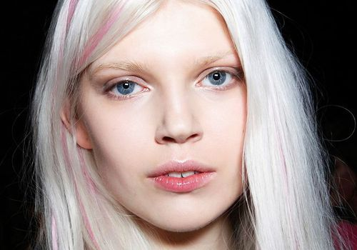 model with pink highlights
