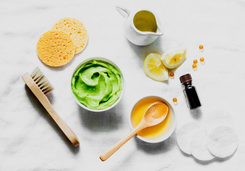 ingredients for avocado face mask on linen cloth