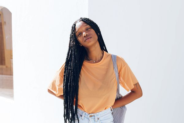 young woman with long braids in the sun
