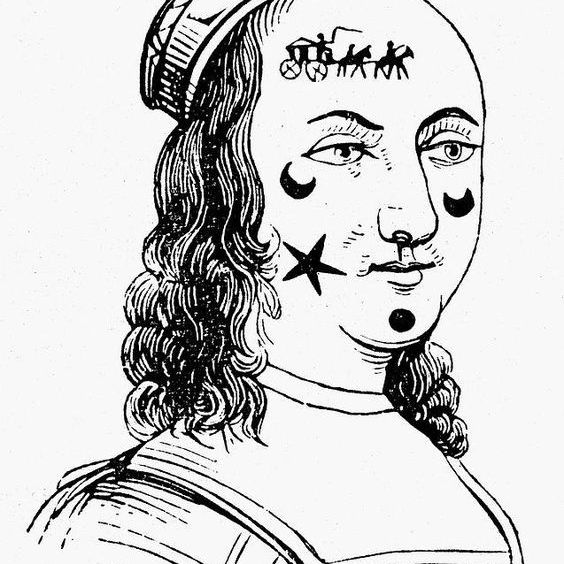 Woman with her facial scars covered by black velvet patches in different shapes