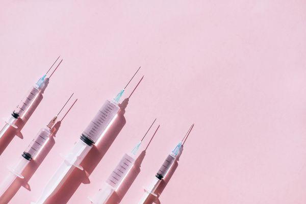 Botox needles on pink background