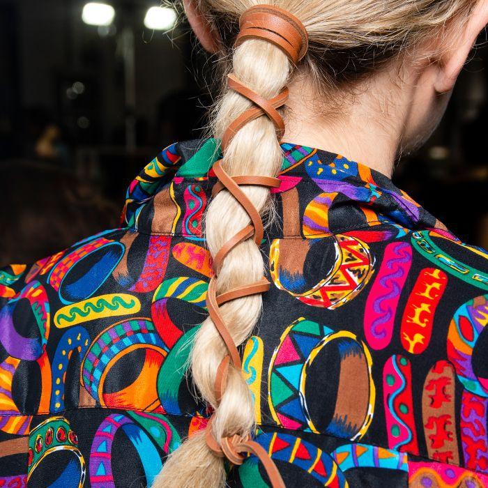 Model wearing her blonde hair in a rope braid
