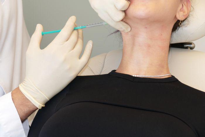 Tanya Akin getting neck Botox injections