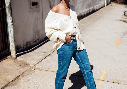 black femme outside in jeans