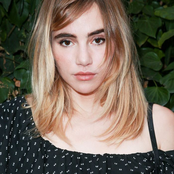 Suki Waterhouse with face-framing layers and side-swept bangs