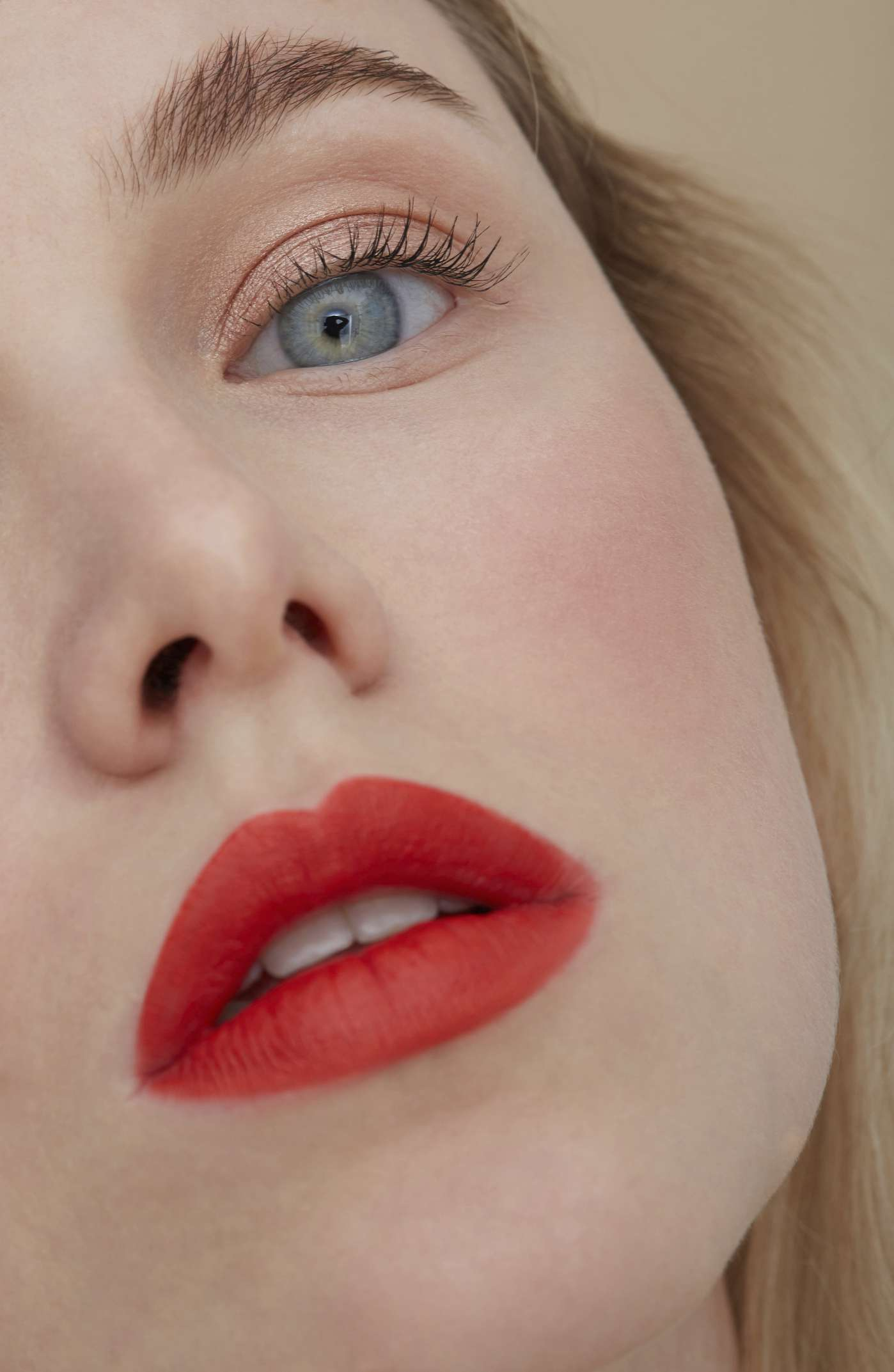 closeup portrait of woman with red lip and intense blush
