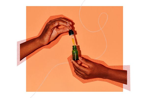jojoba oil dropper with hands and design