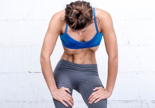 Woman in workout clothes doing yoga technique