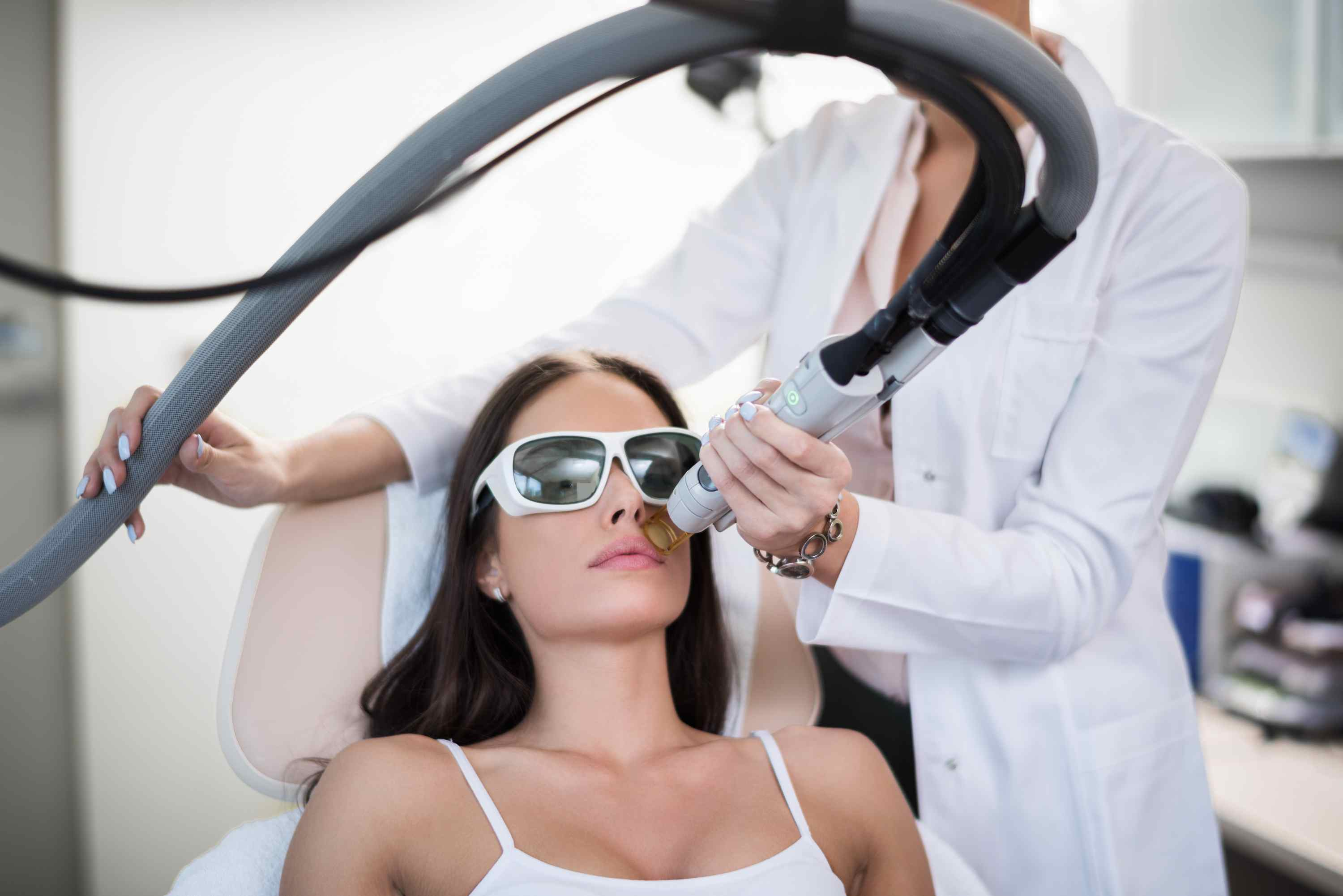 woman getting laser hair removal on her face