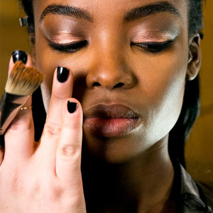 African American woman getting her makeup applied