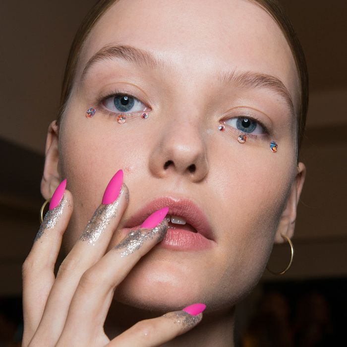 Pink Nails: woman with pink and glitter nails