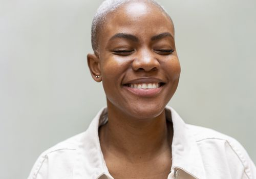 Fresh-faced woman with buzz cut and clear skin