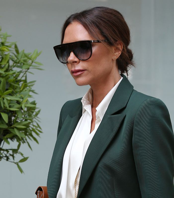 Victoria Beckham Hair: Victoria Beckham with low bun and green blazer