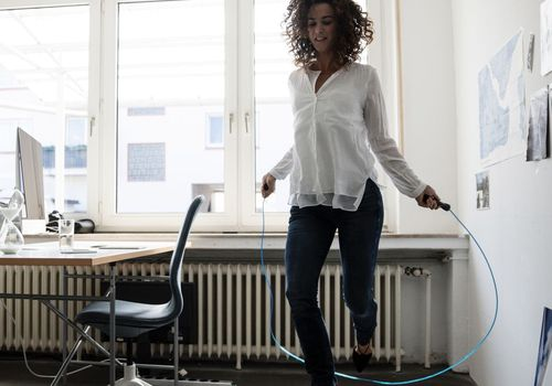 Woman jump rope in office