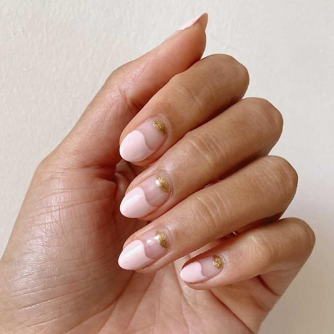 Person with pale pink tips and gold half moon cuticles.