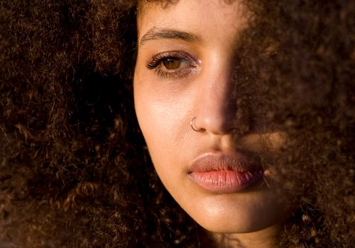 woman with curly skin