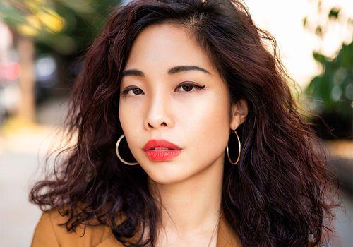 asian femme in full beat outside