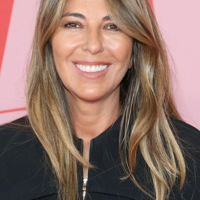 Nina Garcia long hair with highlights and curtain bangs
