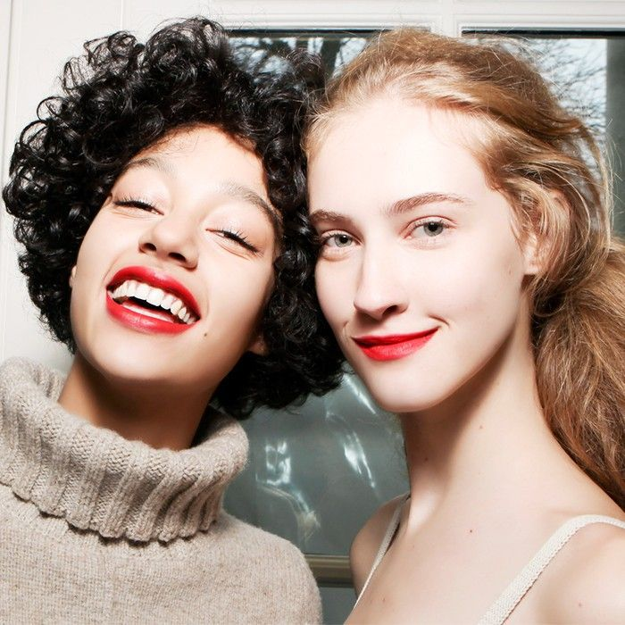 two woman with red lips