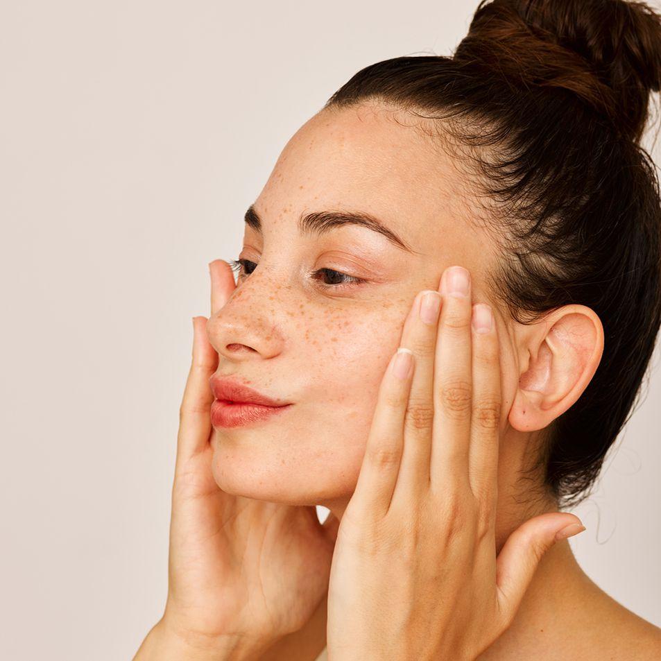person applies moisturizer