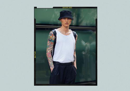 Man wearing a white tank top