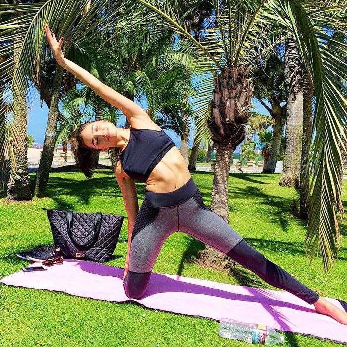 Olivia Culpo doing yoga