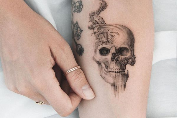 skull tattoo on a forearm