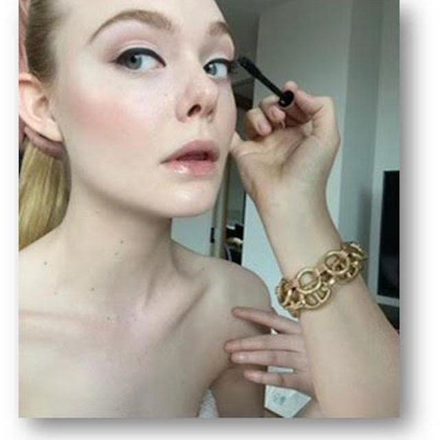 Elle Fanning getting makeup done