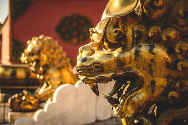 Gold lion guardian statue at the Forbidden City