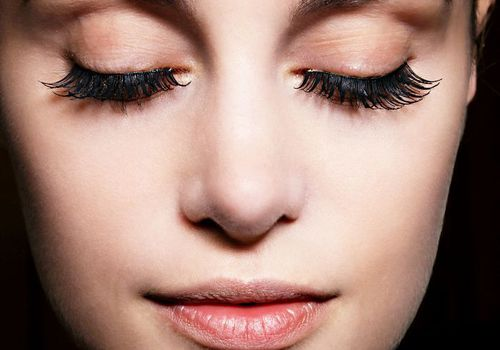 woman with false eyelashes with closed eyes