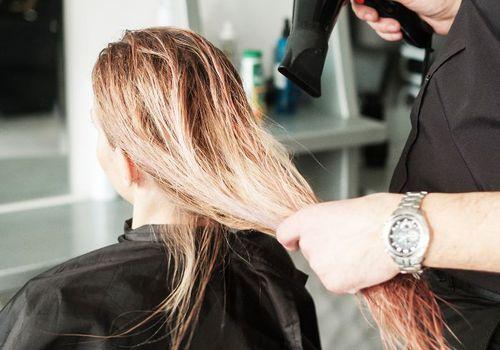 woman getting hair blow dried