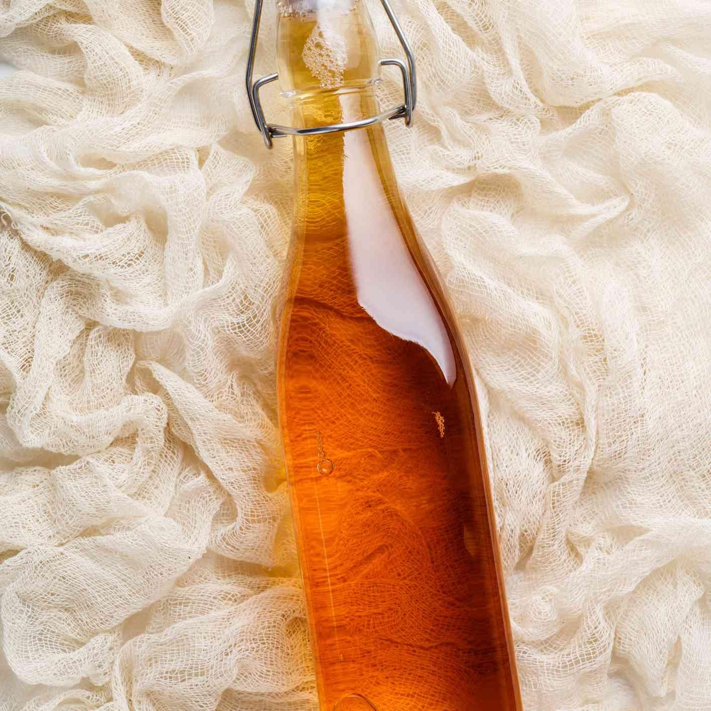 apple cider vinegar on weathered muslin fabric