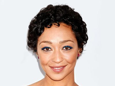 Ruth Negga curly pixie cut