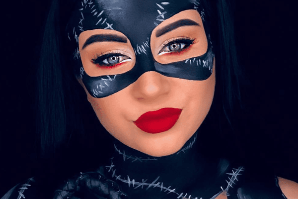 Woman painted as cat woman.